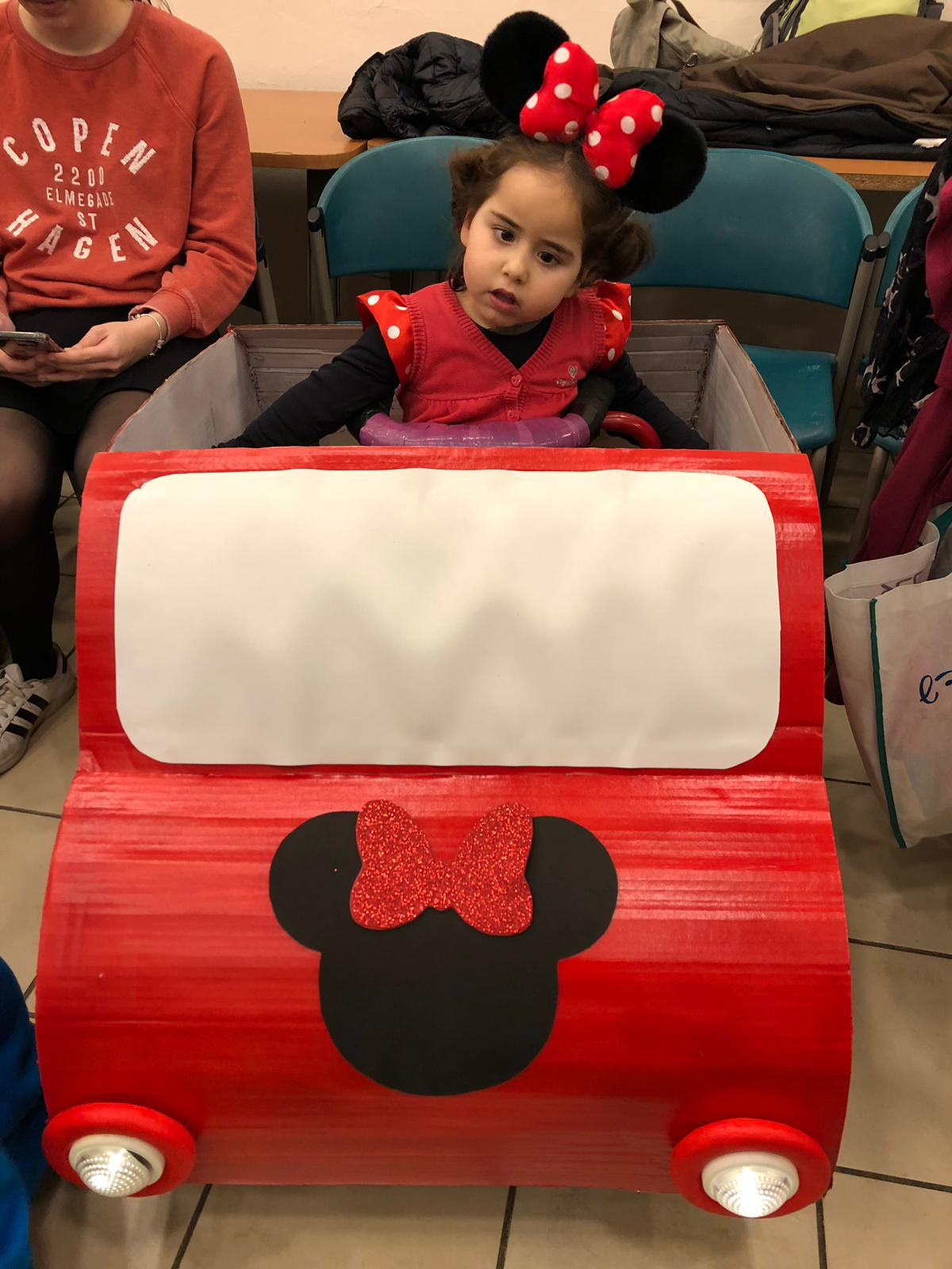 Zohar as Minnie Mouse and her special car: