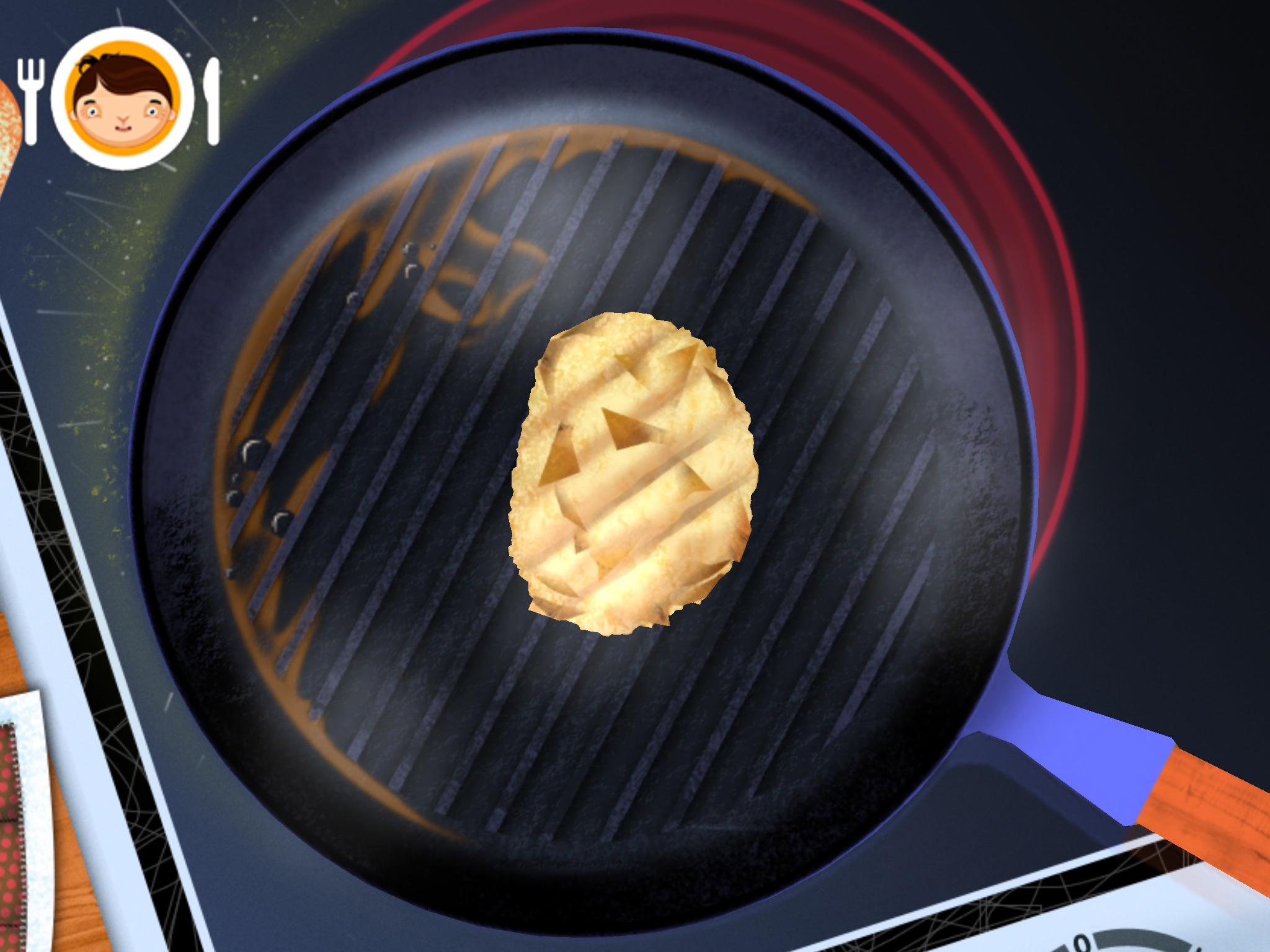 frying pan with potato latke